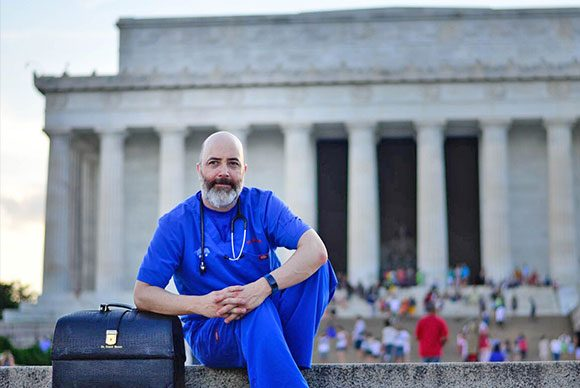 A Doctor sits in front of the Lincoln Memorial