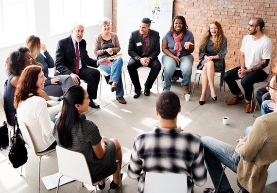 A doctor holds a group therapy session